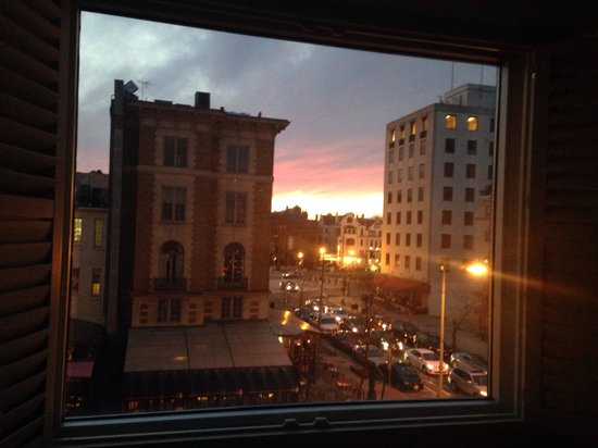 The Dupont Circle: Sunset shining beautifully into our king superior suite on the 4th floor.