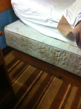 Super 8 San Bernardino/Hospitality Lane: Stain/blood/dirt? on side of bed