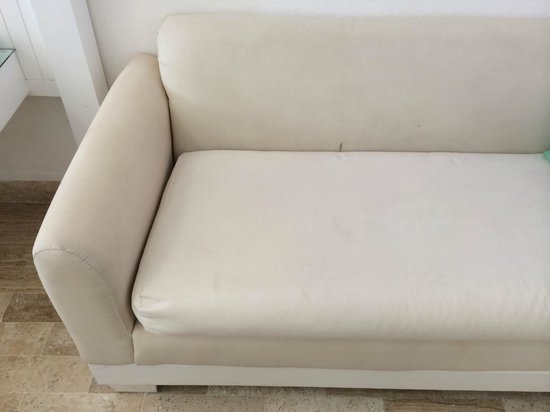 Bel Air Collection Resort & Spa Cancun: Numerous Stain On Couch that Were More Apparent in Person than they are in this Picture