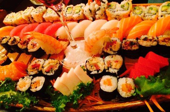 Bangkok Cuisine: Boat for Four. It looks like fresh caught sushi ��