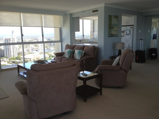 Hi Surf Beachfront Resort Apartments: Living room overlooking skyscrapers and Adrenalin Park where Vomitron and Slingshot can be found