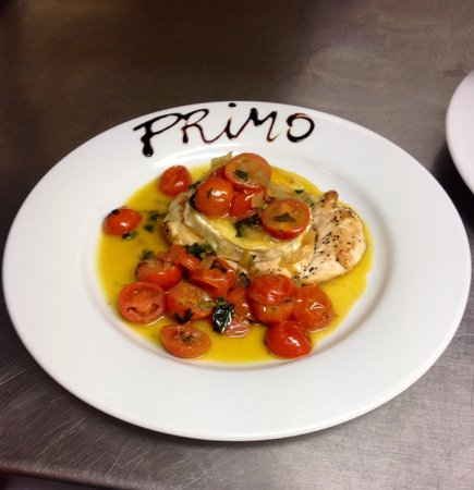 Ashton in Makerfield, UK: Cherry tomatoes,basil,goat cheese together with chicken breast....POLLO NAZIONALE........Perfect