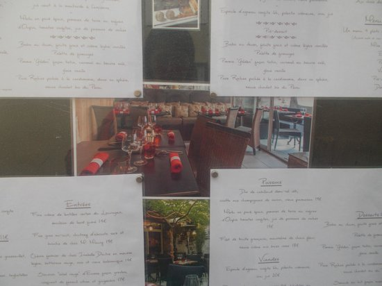 La Table d'Alaïs : Menus and photos on the wall outside