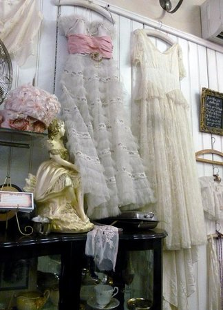 Mona Lisa Garment Gallery: Vintage / antique dresses hanging on the wall