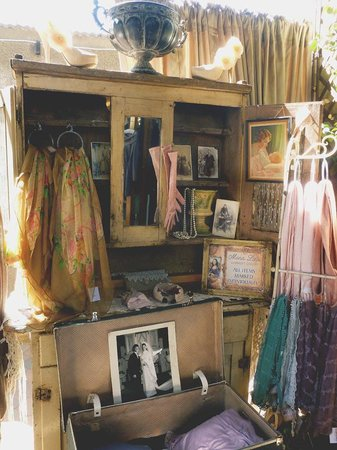 Mona Lisa Garment Gallery: Interesting creative vintage cupboard with display items