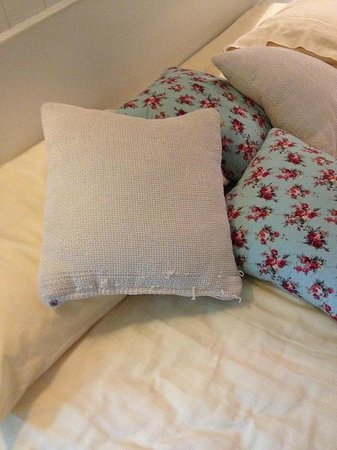 At Pingnakorn Hotel Chiangmai: Bed.  Old bedding.  Throw pillows past prime.. unraveling, no longer clean.