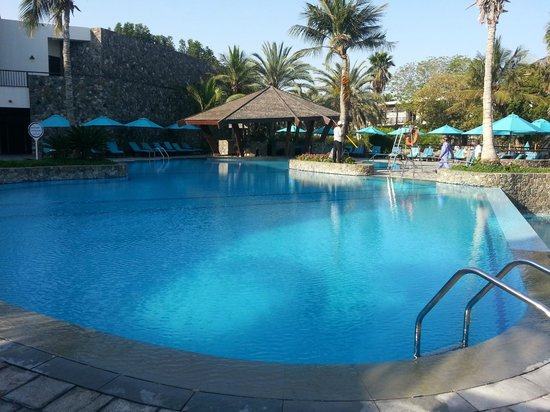 JA Palm Tree Court: pool with anchor bar in pic