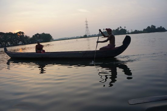 Our Land Island Backwater Resort: Local Boat on River