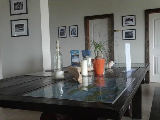 """Two Sandals by the Sea Inn - Bed & Breakfast: """"Expedition"""" planning table, with maps and guidebooks."""