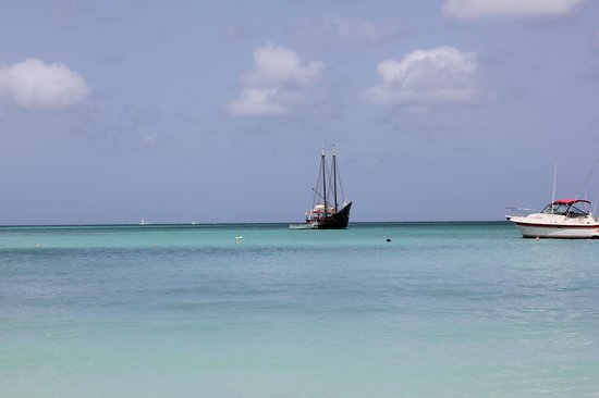 Marriott's Aruba Surf Club: Beautiful, empty beach.  Looking at the Jolly Pirates ship (and DH's head)