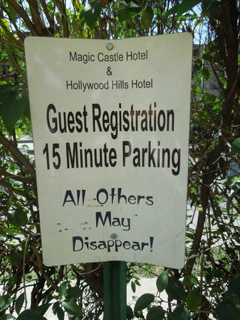 Magic Castle Hotel : Parking is available onsite. This cute sign is out the front.