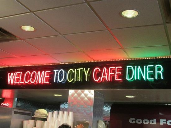 City Cafe Diner: Vintage Neon Welcome sign inside the dining area