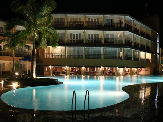 The Palms Hotel: looking across the pool at night