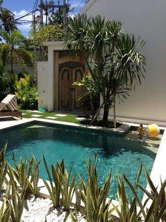 Pool and door to 1-bedroom villa