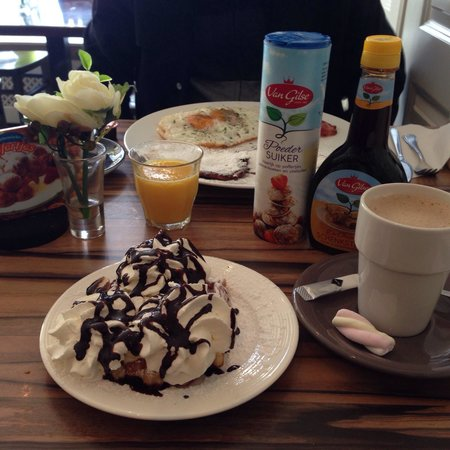 Sara's Pancake House: Waffle with banana, whipped cream, and chocolate; American breakfast, and coffee latte