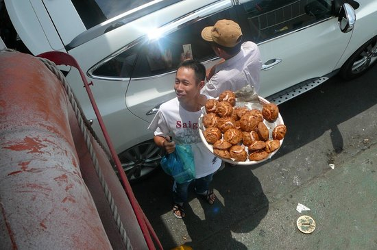 Water Buffalo Tours: Tam buying mung bean cakes on the ferry