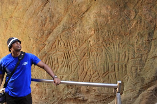 Edakkal Caves : Vinfred checking out the carvings
