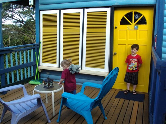 Adventure Eco Villas: Kids playing on the porch of our villa
