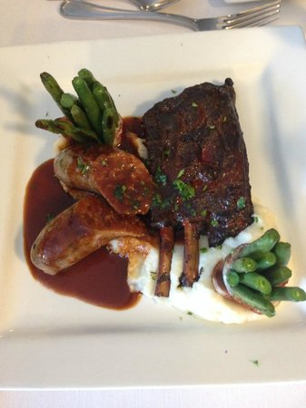 Cafe Berlin: Smoked Wild Boar Ribs and Sausage w/green beans wrapped in bacon and garlic mashed potatoes