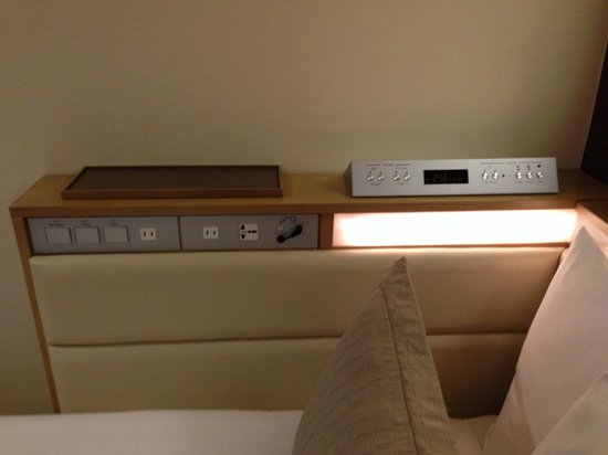 Hotel Ryumeikan Tokyo: Electic outlets and wake-up control panel.