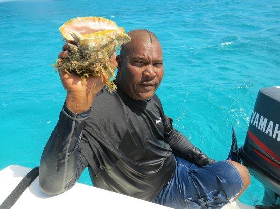 Papa J Tours: Gary brings up a conch