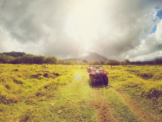 Original Arenal ATV: Farmland  in front of Arenal Volcano with craters from the eruption from the '60s still visible.