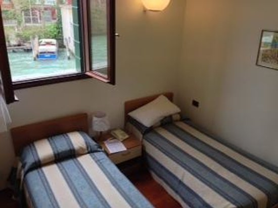 small room, with 2 single beds, overlooking the canal   Picture of