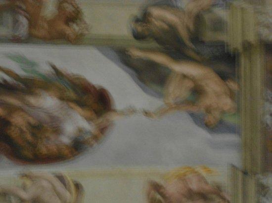 Sistine Chapel: Pintura de Michelangelo no teto da Capela Sistina. Essa não poderia ser fotografada, mas tentei.