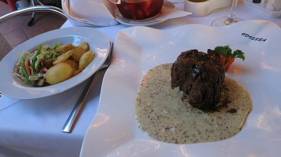 Odissea Restaurant: House special - steak with potatos - the most delicious meat I have ever tasted!