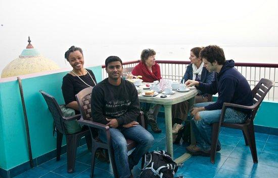 Kedareswar Bed & Breakfast: Sunnu our trusty guide on rooftop terrace at breakfast