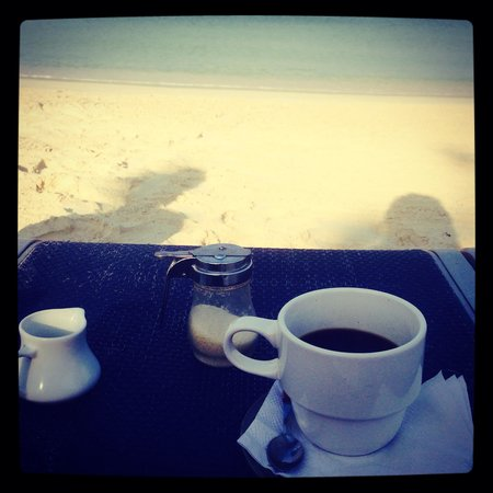 Freshly brewed coffee delivered on the beach. One of the many perks that Posada Seremein had to