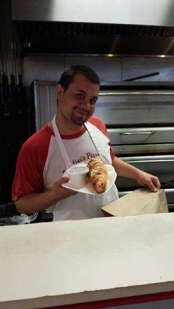 Landini's Pizzeria : freshly made meatball roll.