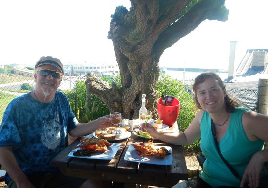 Tolbos Bistro: In the corner table by the big tree, enjoying our crayfish feast
