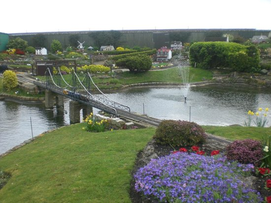 Merrivale Model VIllage: Model train on bridge over pond