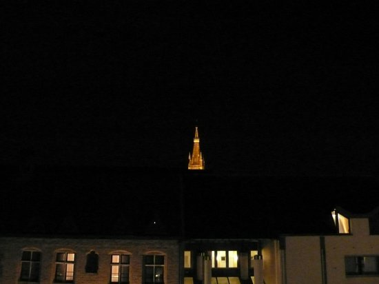 Novotel Brugge Centrum : Town tower at night from room