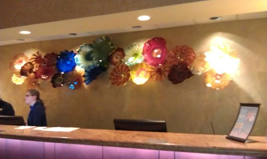 University Plaza Hotel and Convention Center: interesting glass art by the front desk area