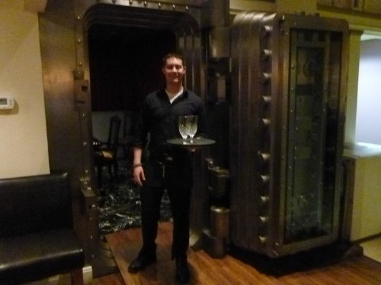 The Dancing Fig: Server at vault entrance - private dining room