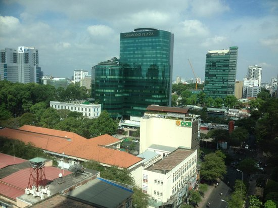 InterContinental Asiana Saigon: view of Diamond Plaza - department store-white building in front of the blue glass building