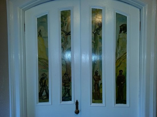 Express St. James Hotel: The beautiful painted door dividing rooms in the Wyatt Earp room.