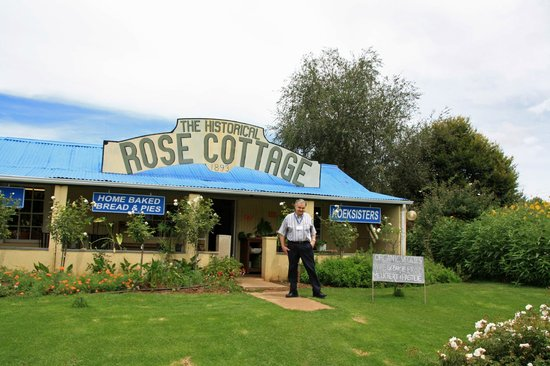 The Rose Cottage & Co: Photo of cottage with me in front