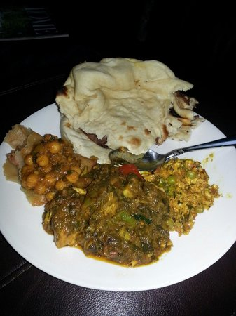 Maya: Chicken Hara Aachari and Paneer Purji with Samosa Chic Peas and Naan.