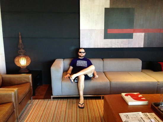 Porto Bay Rio Internacional Hotel: My husband hanging in the hotel lobby