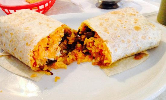 Taco's El Norte: Torpedo Burrito! Grilled steak, cheese, rice, & eggs over easy inside. So good!