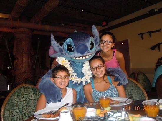 Stitch hugging the stuffing out of my daughter  - Picture of 'Ohana