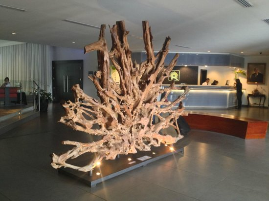 Riande Aeropuerto: Wood sculpture greets guests upon arrival at front door