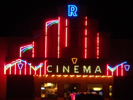 It's Just Perfect: Glitzy neon theater behind shoppe