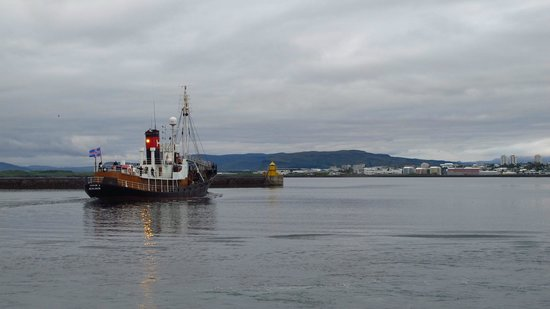Reykjavik Bike Tours : The first whaling ship of the season heading out to sea.