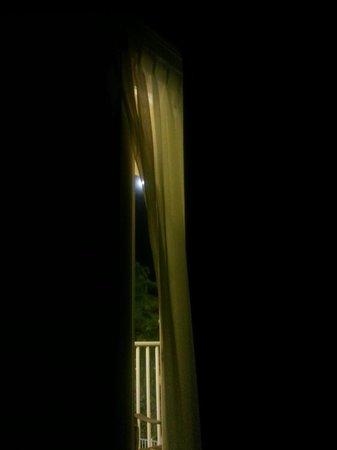 Treasure Bay Resort & Marina: view of moon from bed - door open, sea breeze