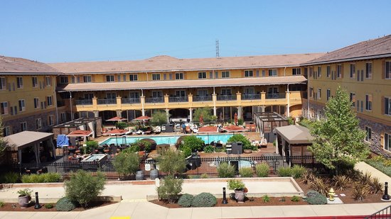 The Meritage Resort and Spa: View of the pool and the hotel from the hill walk to the Grape Crusher