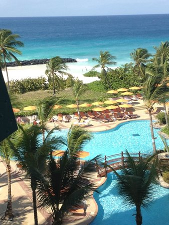 Saint Michael Parish, Barbados: View from room 203, of pool and beach.  Note rock break wall on left side.  Note break wall on l